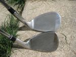 comparing the size of a Wilson Sand wedge head and a Founders Club Pitching wedge